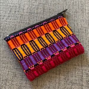 Hand made multi-colored pouch with a zipper